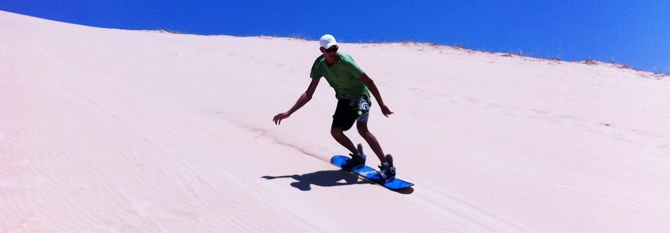 SAND BOARDING IN JEFFREY'S BAY